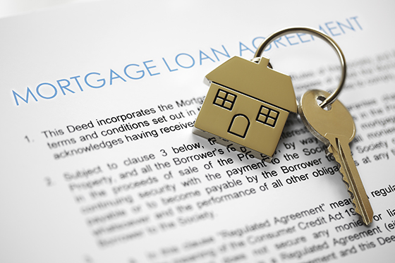 FHA housing mortgage loan application with keys on a house shaped key chain