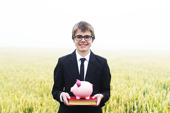 Student with a piggy bank and book